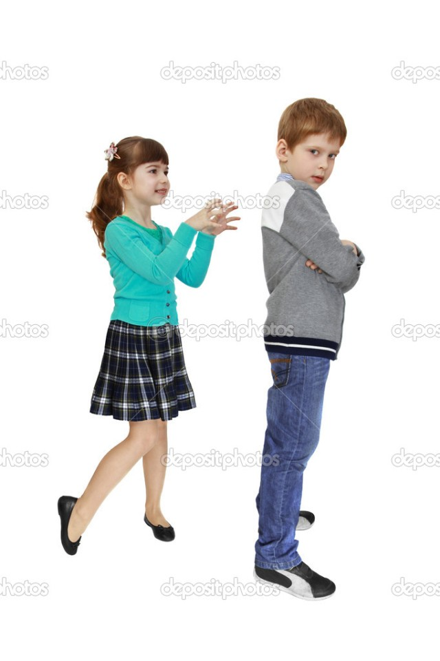 Girl scares boy standing back to her isolated on white background